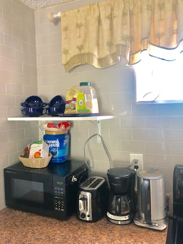 Some details of the kitchen, though all the tools and amenities of the kitchen are not shown ... coffee and tea, wine glasses, mugs, bowls, plates, plenty of silverware, wine opener, beer opener, strainer, pots and pans, etc all included.