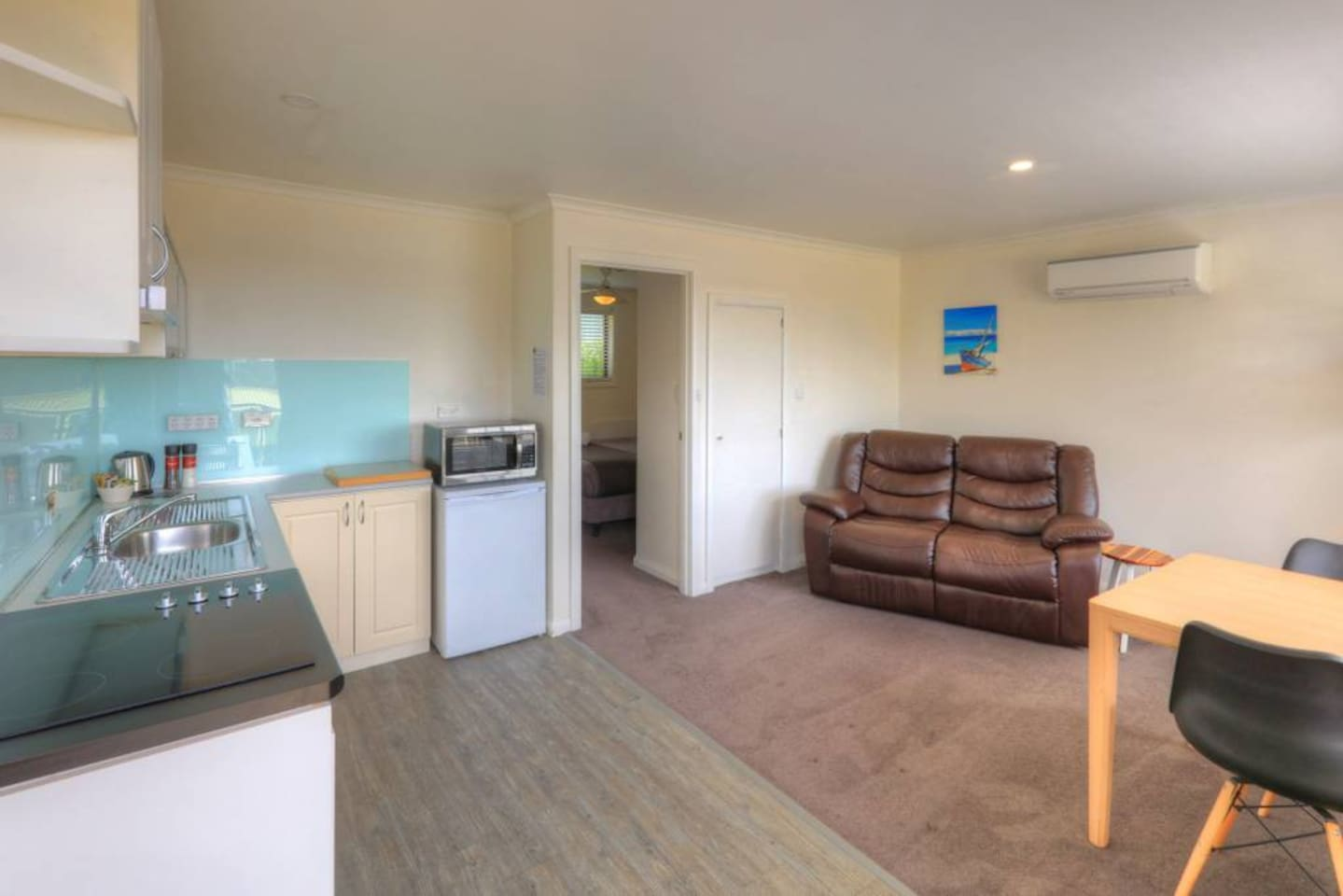Living Area with Stove Top, Fridge, Kitchenware and Reverse Cycle Air Conditioning/Heating