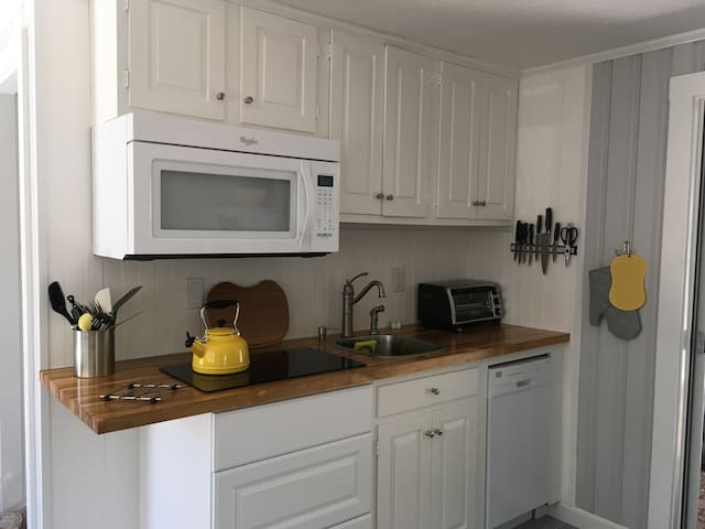 Tiny house living! Full sized microwave with baking capabilities, induction cook top, deep sink and dishwasher!!
