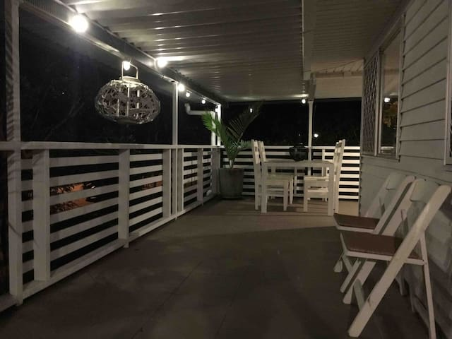 Enjoy the quiet sound of crashing waves from the beautiful treed deck by night