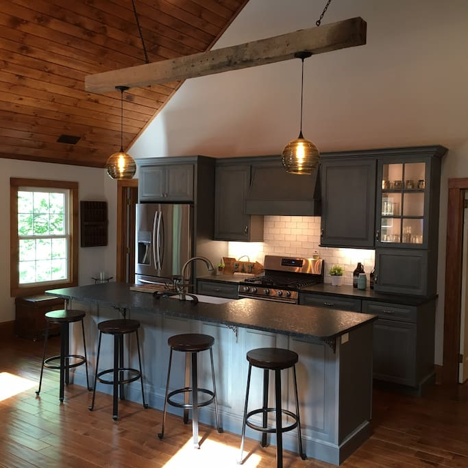 Open Concept Kitchen, Living, Dining with vaulted ceiling