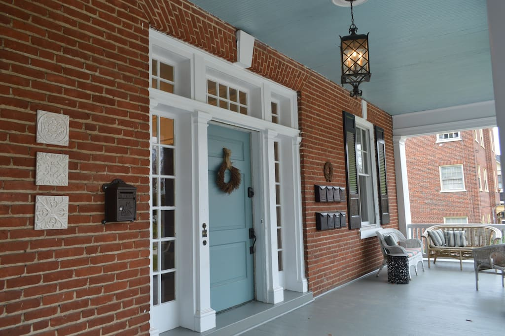 Front porch and door with combination lock.