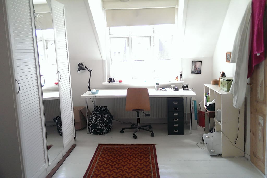 My desk in the bedroom and a big mirror
