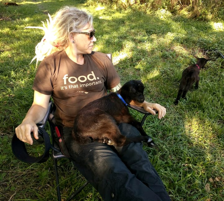 Relaxing with kid goats.