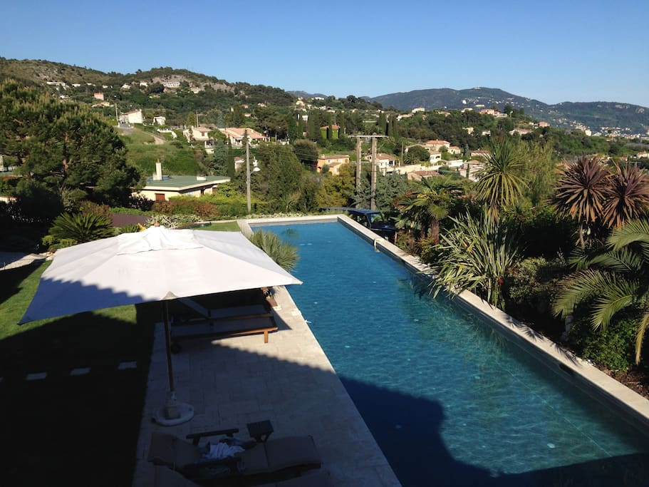 View of pool and hills from the apartment terrace