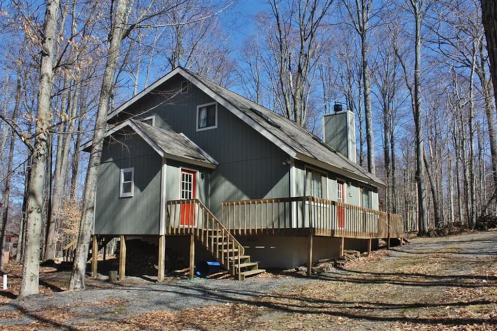 You will love this home's peaceful, wooded setting within the Locust Lake Village development