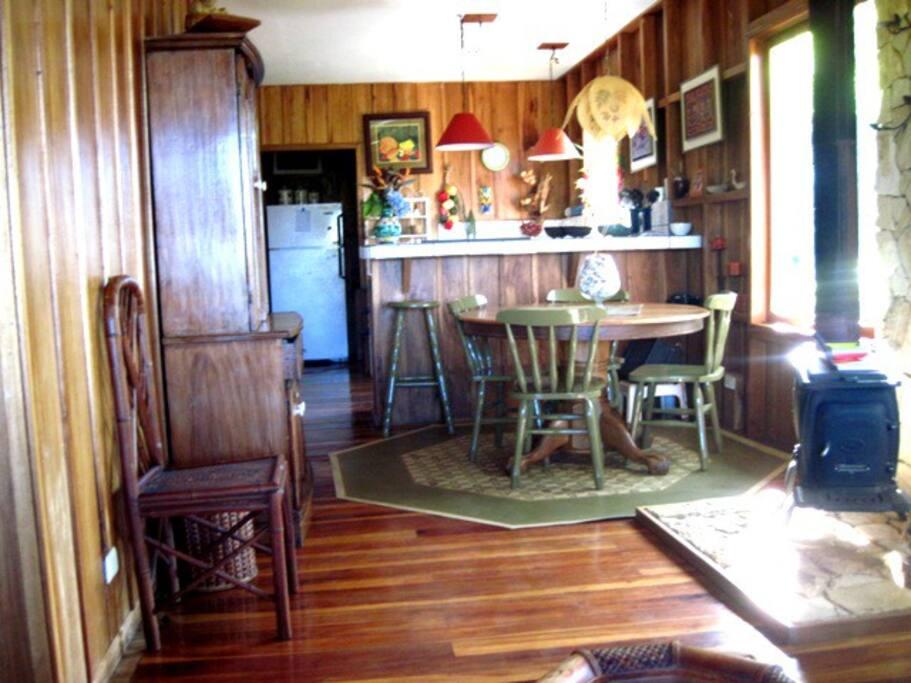 Dining area, breakfast bar, wood stove