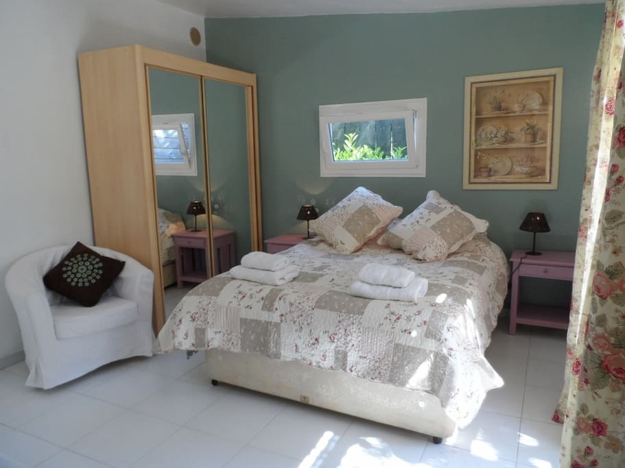 The double bedroom with en suite shower room and toilet.