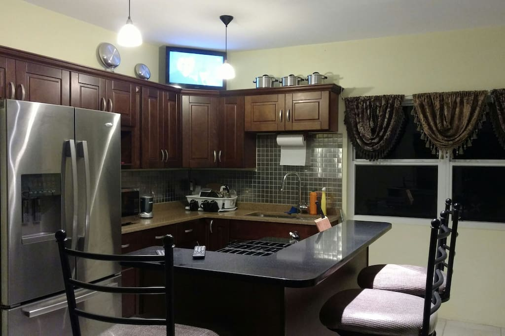 kitchen area with island and TV to watch