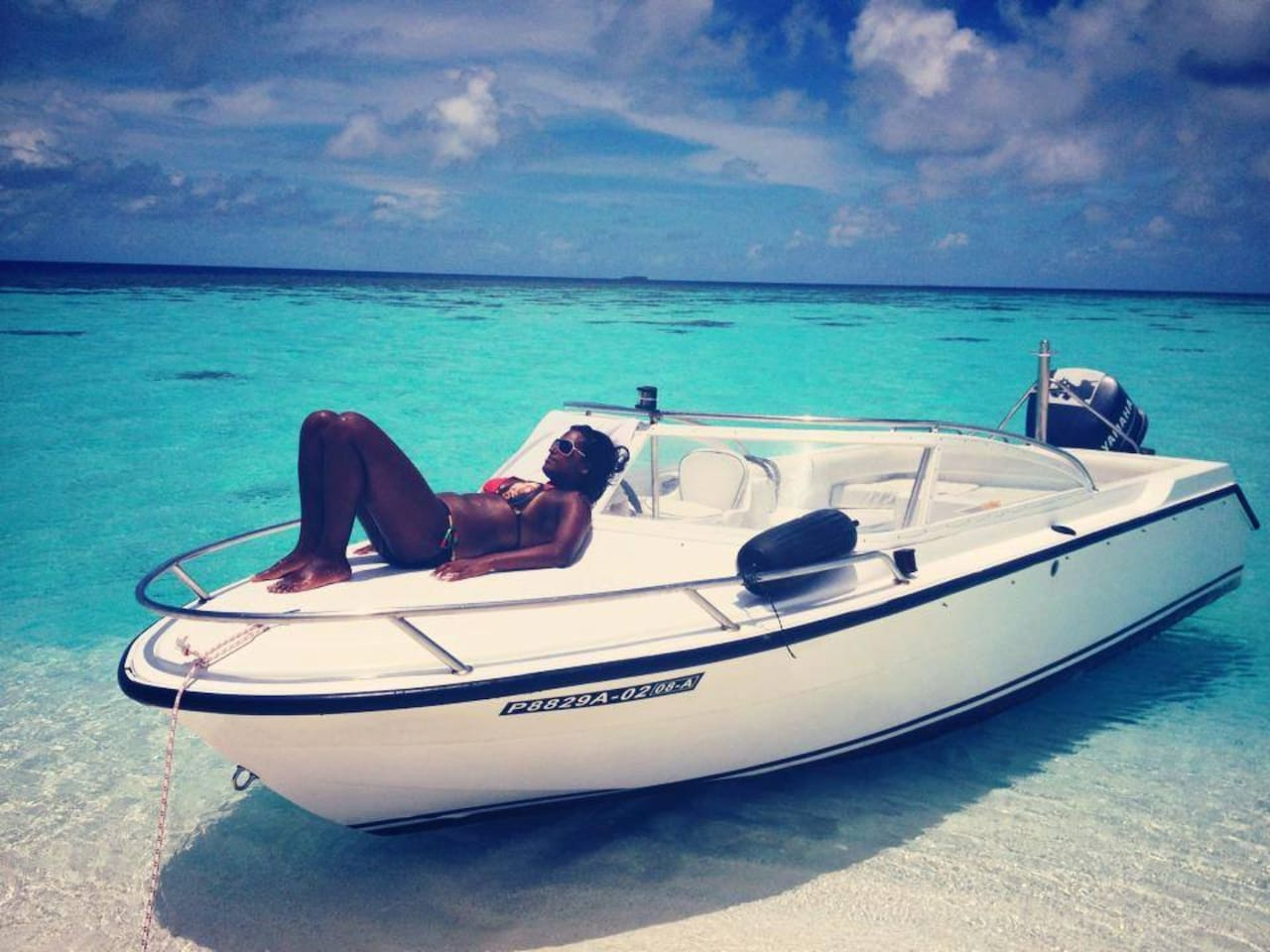Our lovely guest Shirona getting some sun on Noovilu speedboat.