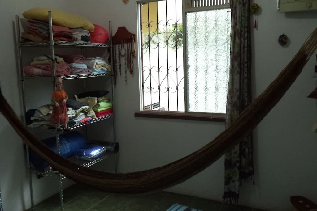 room to sleep in a hammock, air conditioning, rack for storing clothes.
