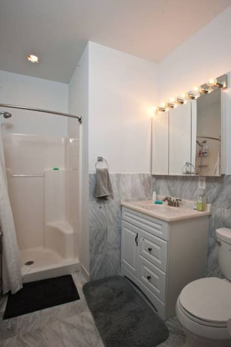 Bathroom with marble tile and large shower