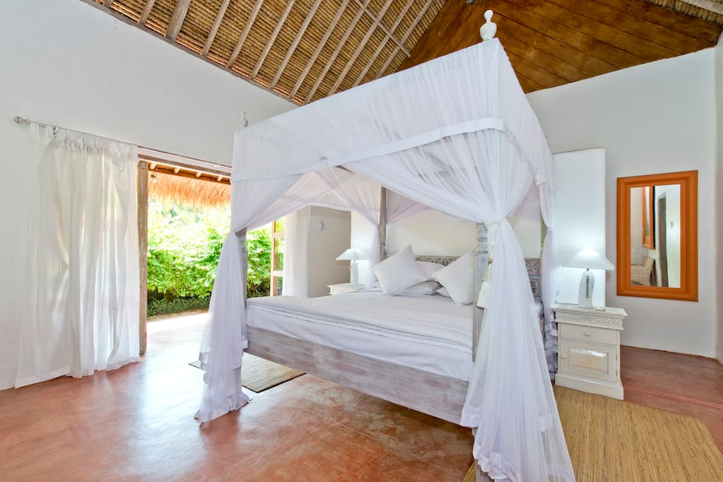 The 'Frangipani room with it's huge King size canopy bed.
