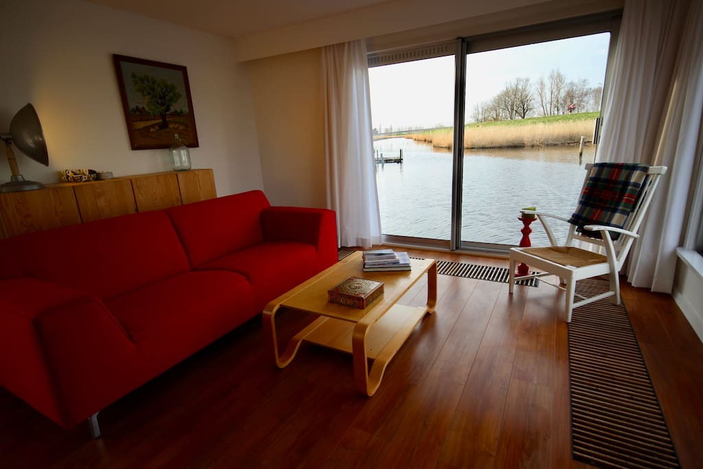 Our cosy living room with amazing view over the canals