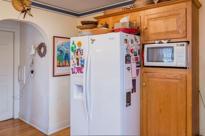 Fully stocked fridge; microwave for your convenience