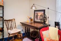 Desk corner of the bedroom; adjustable lighting for computer use