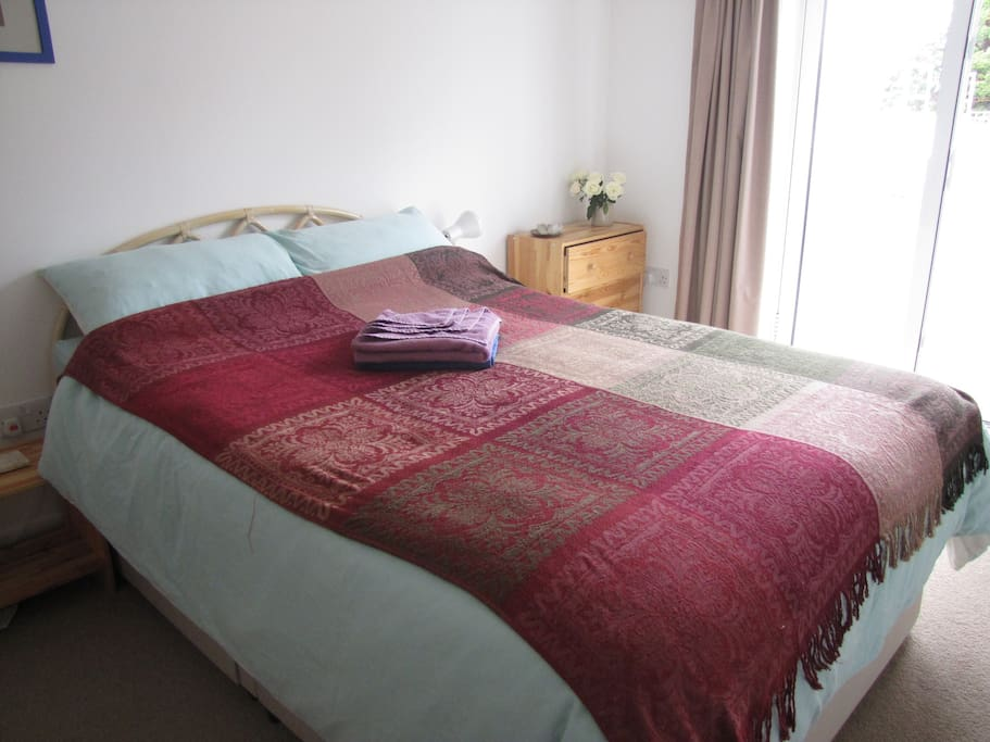The double bedroom with double bed, comfy king size duvet in a light, spacious, modern, clean and fresh room