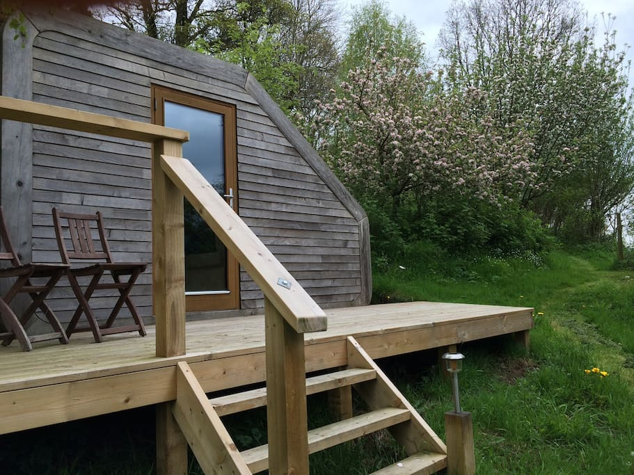 In Spring the Pod is surrounded by apple blossom and wild flowers