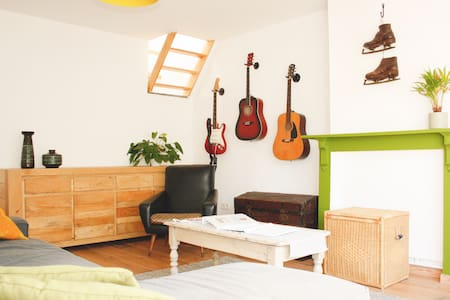 Sunny rooftop apartment + 2 citybikes included