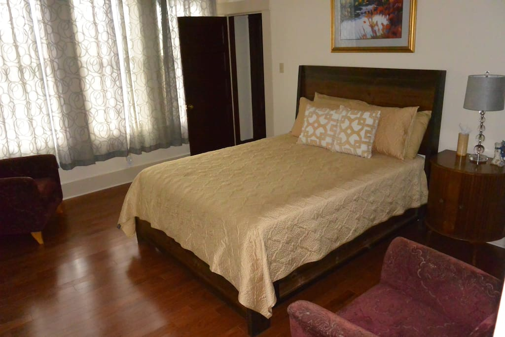 Comfortable queen-sized bed in a private bedroom with attached bathroom.