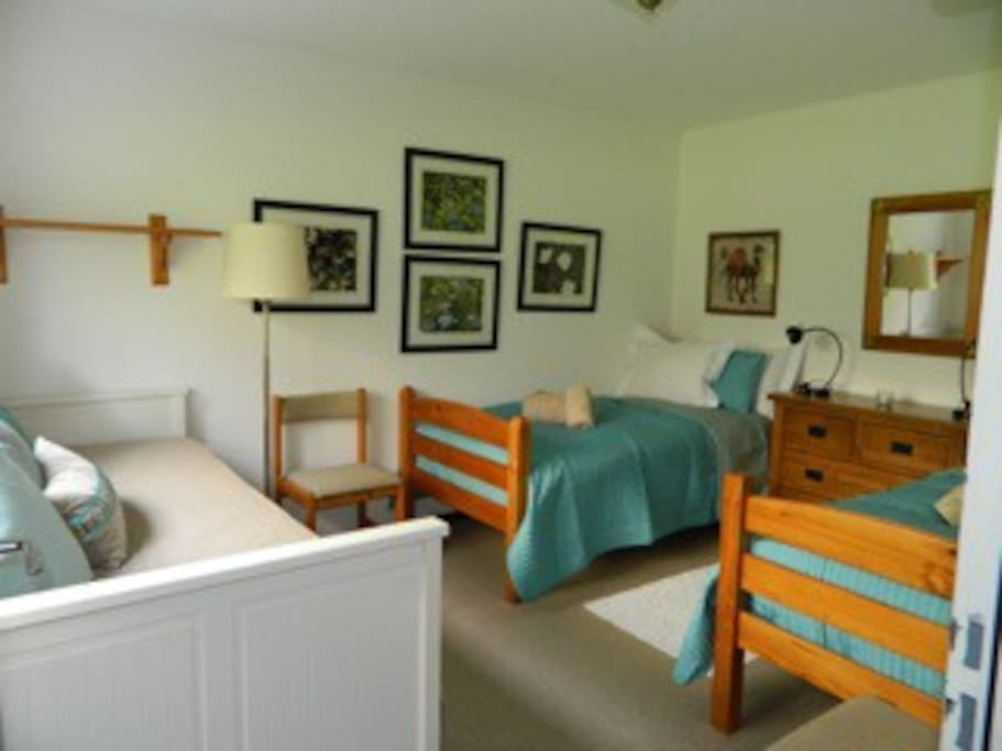 Bedroom with 2 single beds and 1 pull out double bed