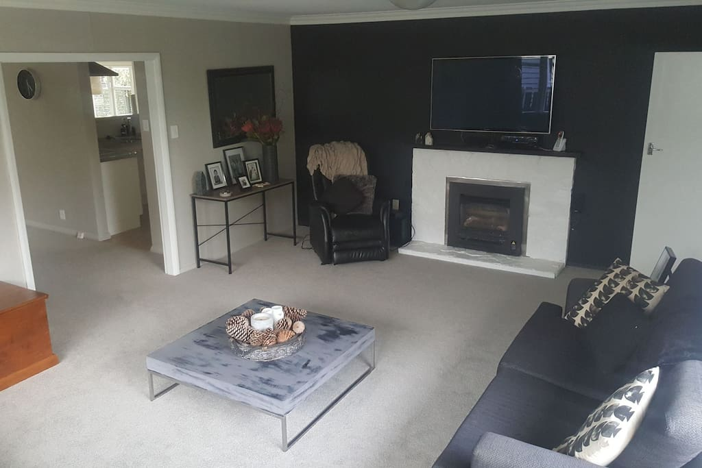 Second lounge with Tv and gas fire.plenty of comfortable seating to enjoy this space