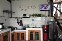 Kitchen with full set of cooking utensils, refrigerator, microwave, ricecooker, water dispenser, stove also bread n jam for breakfast