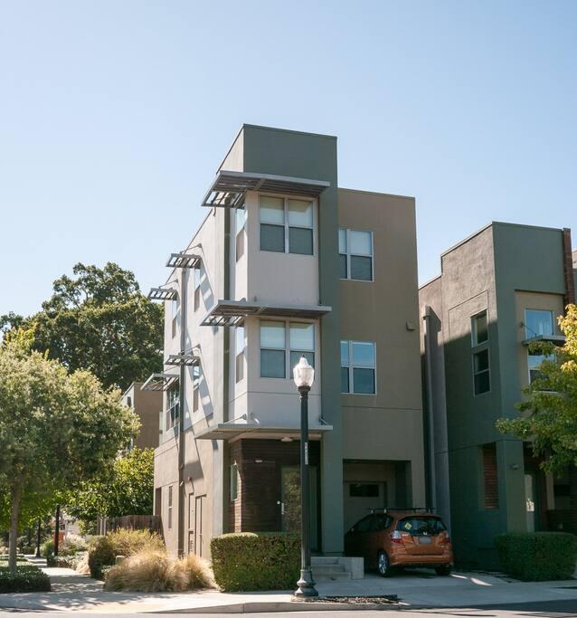 3-stories with lots of windows. Driveway parking spot, plus plenty of on-street parking