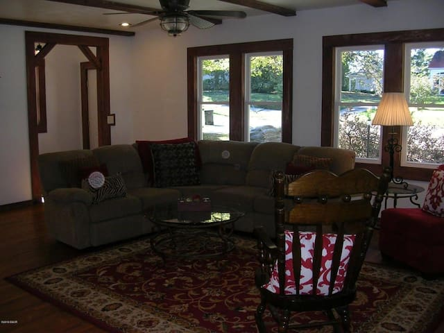 The first room you will enter is, the spacious living room. We have plenty of sitting area for you and your family to sit around relax and enjoy each others company. There is also a tv on the fireplace mantel.