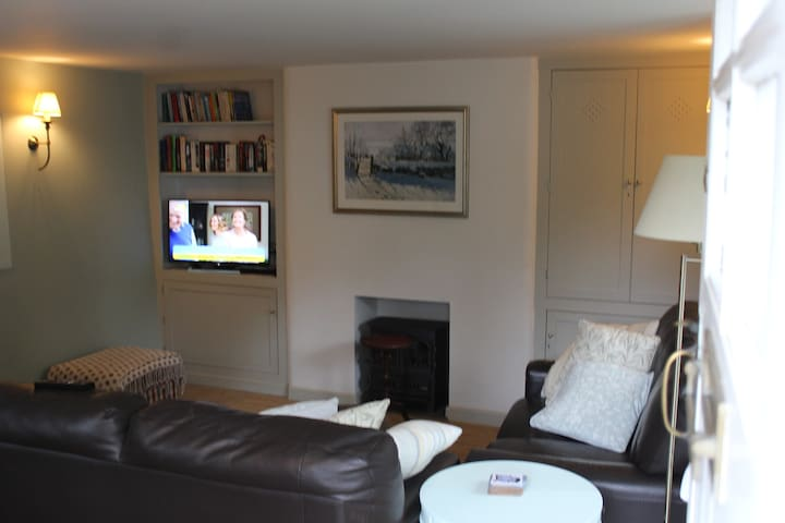 Living room with TV shown.