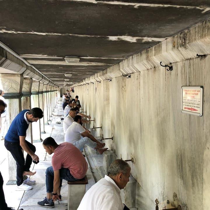 Men taking pray ablution