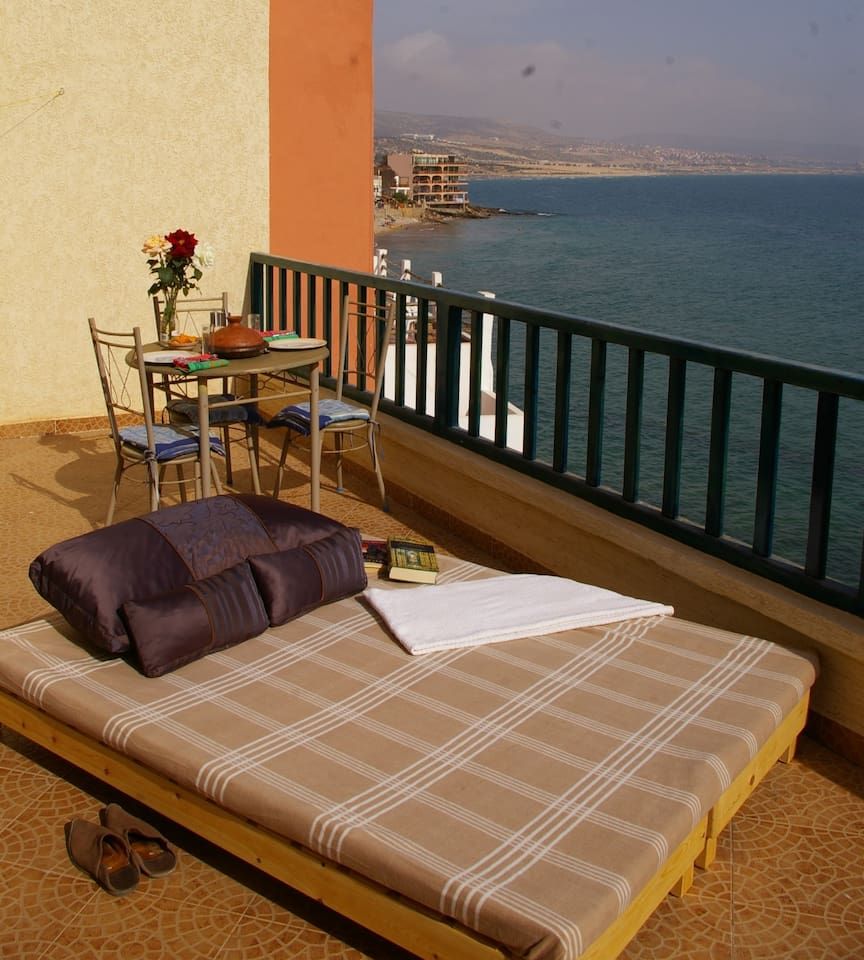 Terrace with a wonderful view over the bay, with a comfertable sun bed.