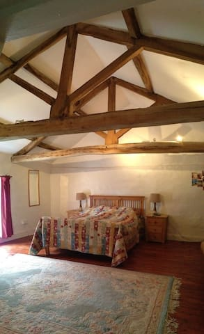 The double bed room also has a double set of beams