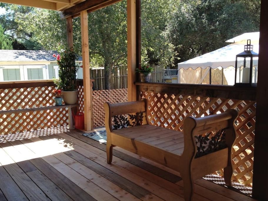 Newly enclosed back patio, large table, gas stove and mini fridge.