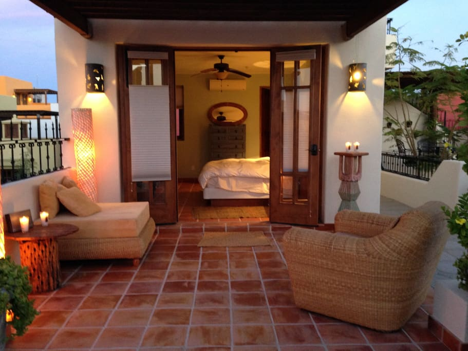 View of the upstairs master bedroom with patio at dusk