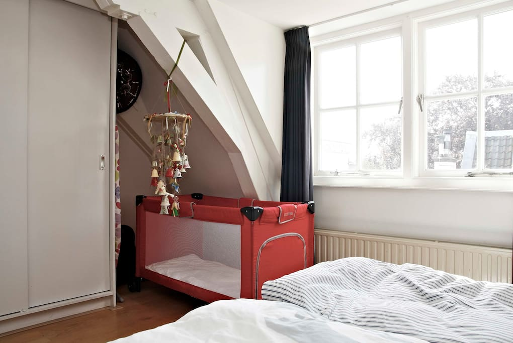 Master bedroom includes movable cot for small child