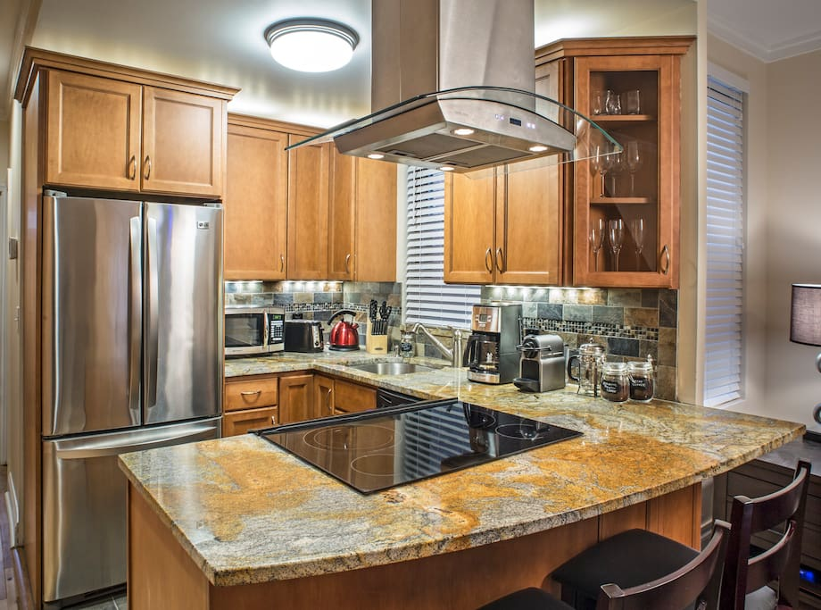 Newly remodeled kitchen with all stainless steel appliances stocked with all necessary appliances and utensils