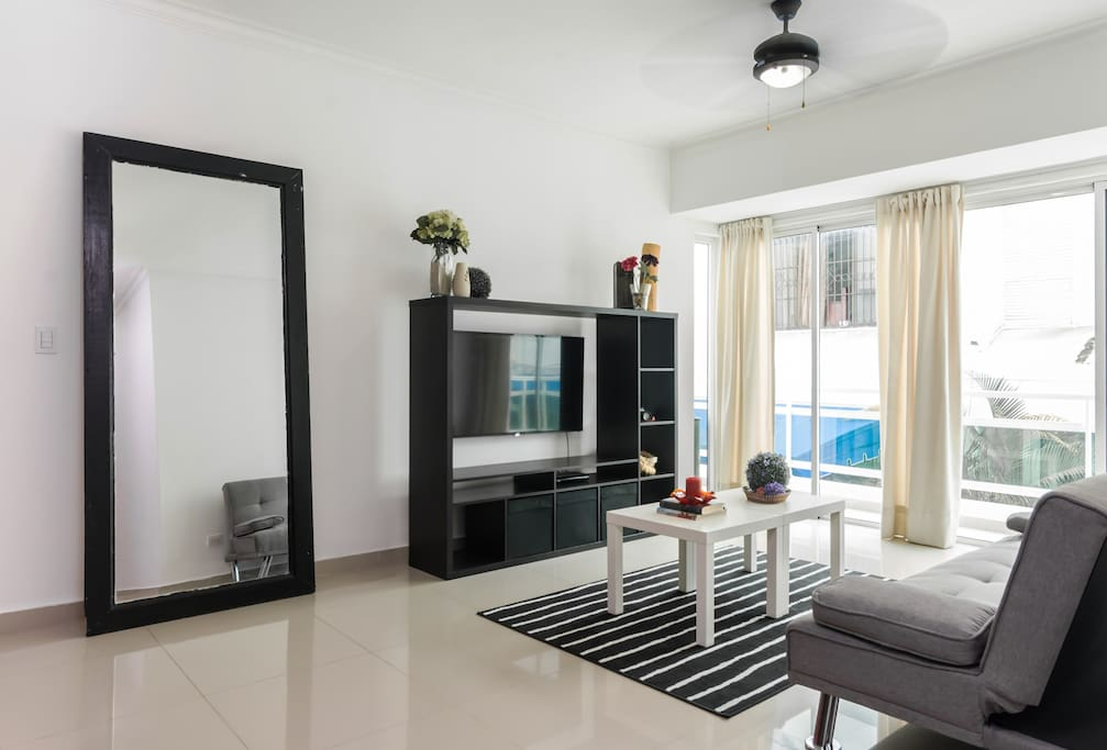 The livingroom comes with an open fully equipped kitchen, balcony, seating area, Smart tv with cable, wifi and a ceiling fan.