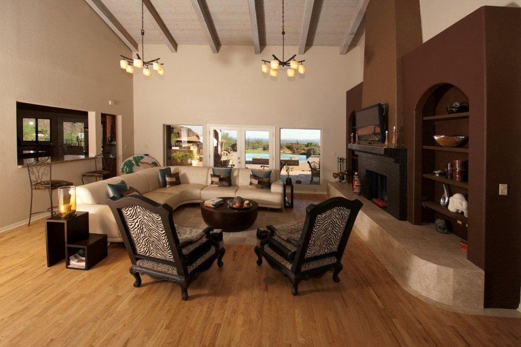 Living area with flatscreen TV over wood burning fireplace