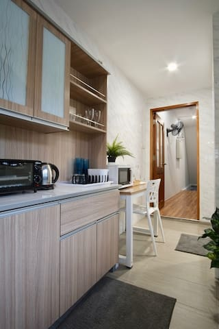 Our well-equipped pantry area is shared by all guests.