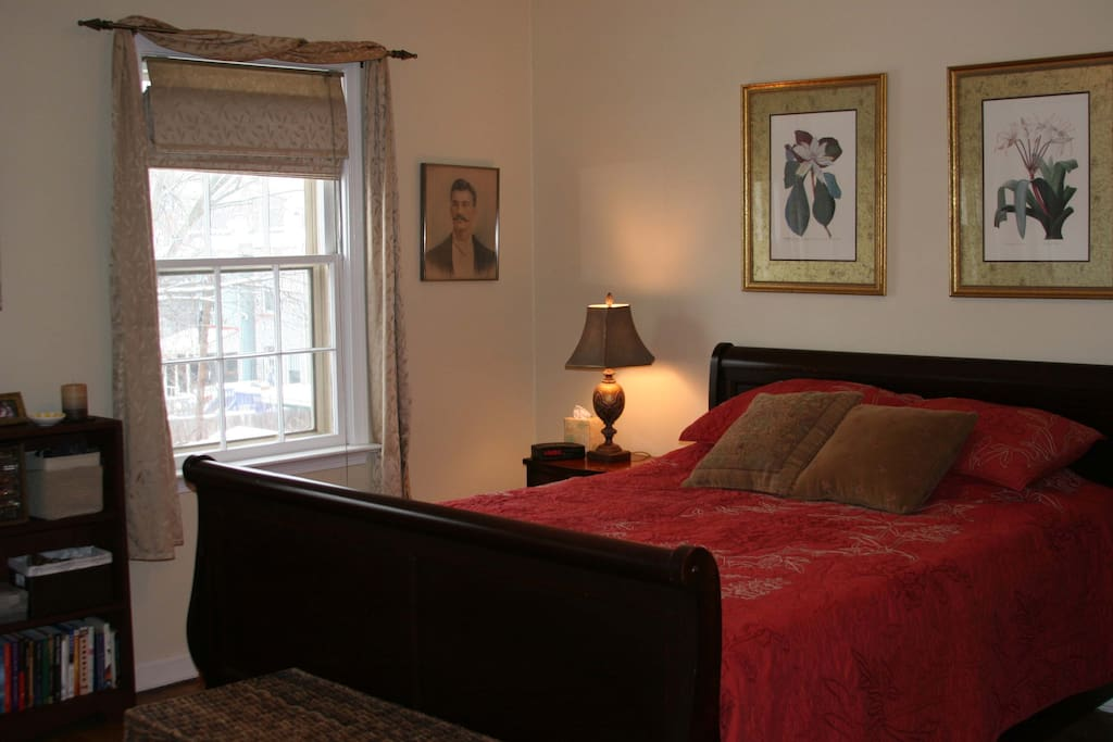 Master bedroom with queen bed and memory foam mattress topper