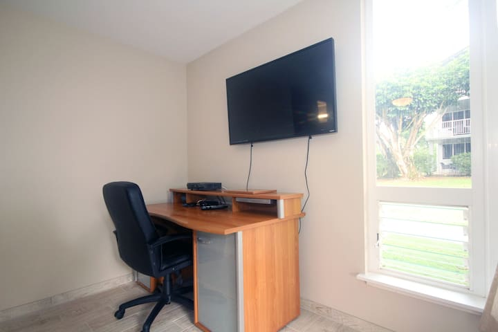 Office in master bedroom... so you can answer a couple of quick emails. (and super fast wifi, 30mbps)
