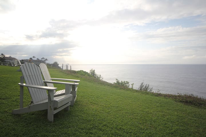 A few adirondack chairs with views off the north shore.
