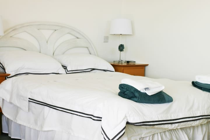 The main bedroom with Queen sized bed and ensuite bathroom.