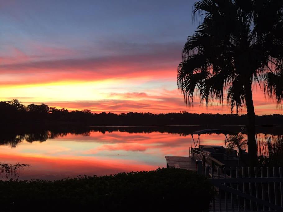 Sunrise .  View from deck with pontoon boat.