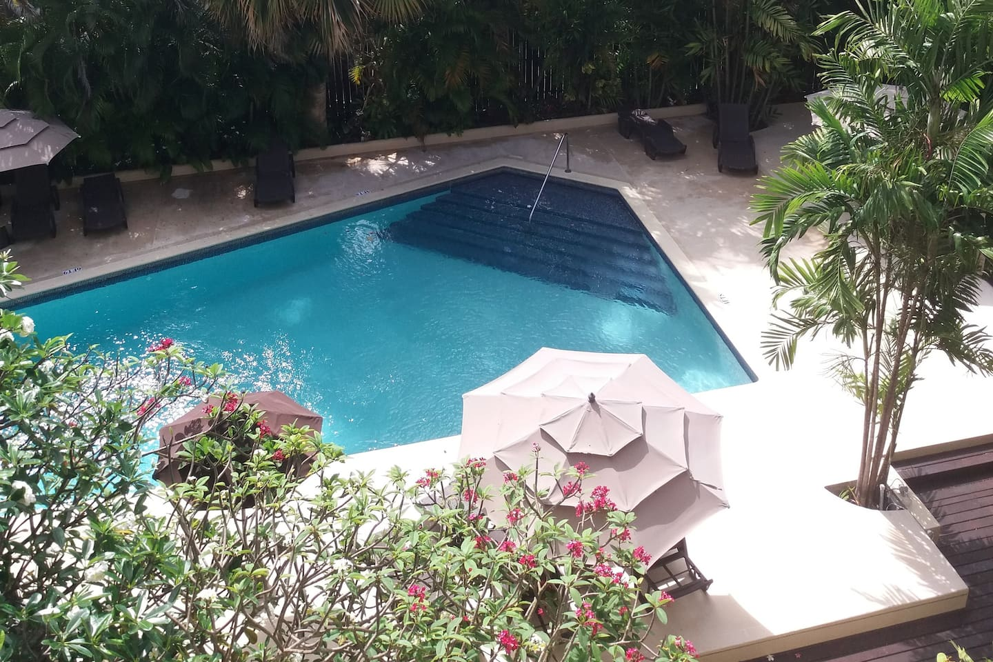 Wake up to this view of pool from the bedroom balcony
