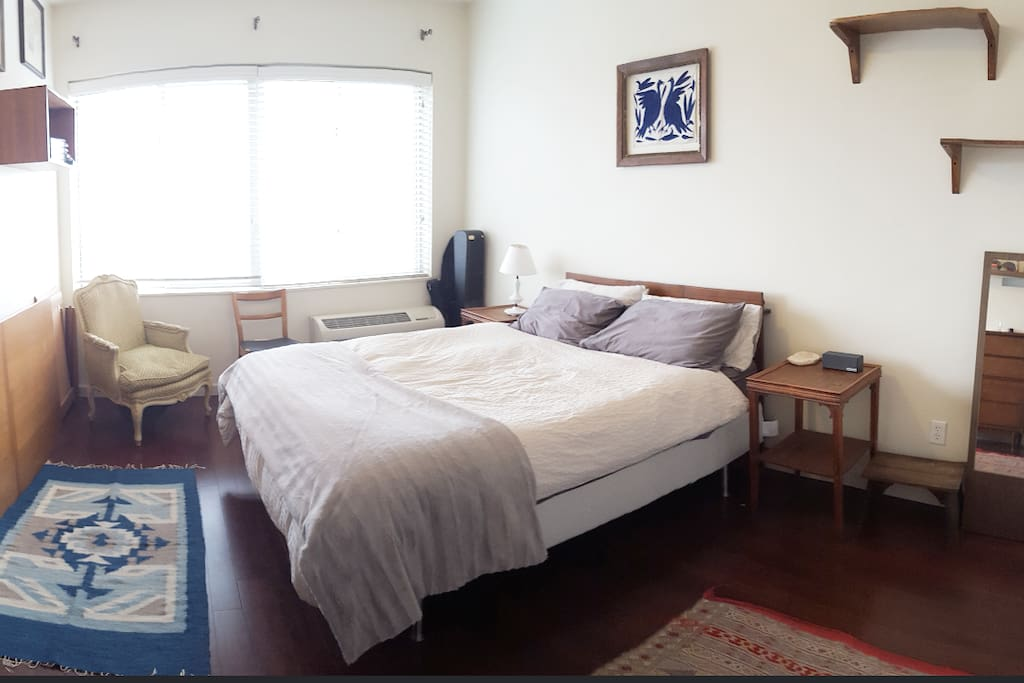 Spacious and bright bedroom with a memory foam queen size bed.