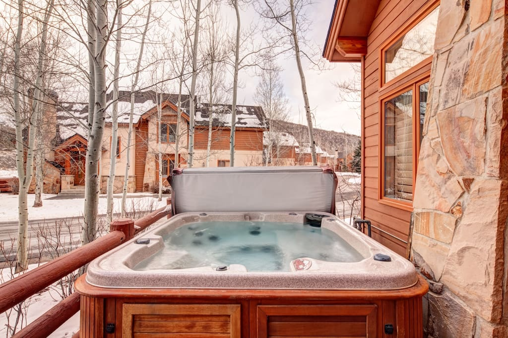 Enjoy a soak in the private hot tub on your deck after a day on the slopes