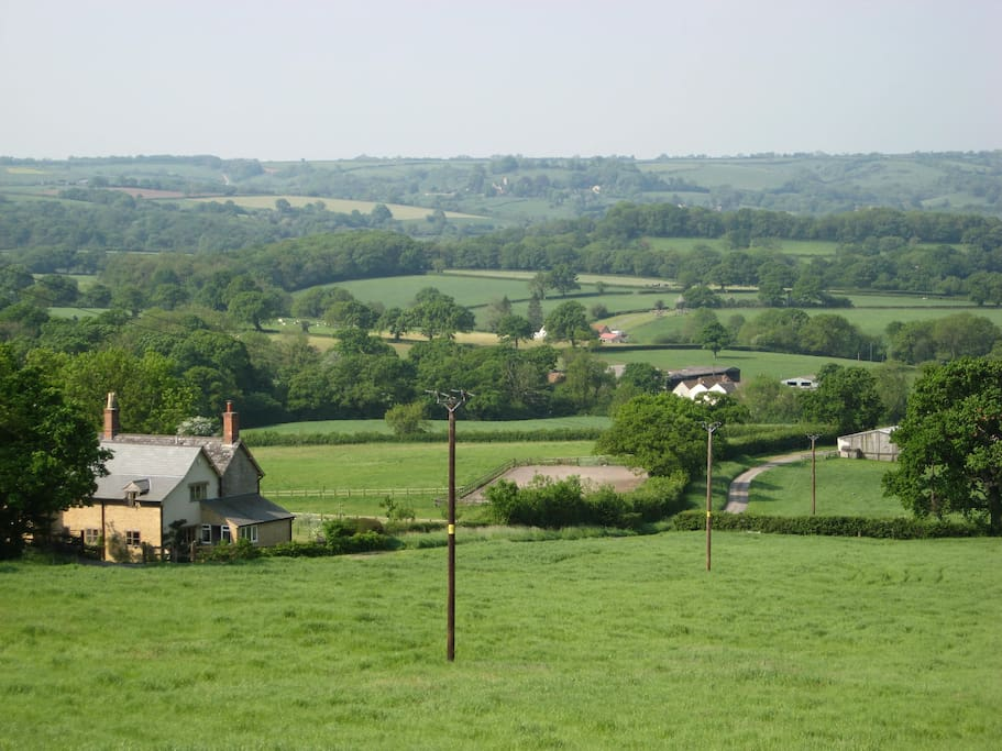 The house surrounded by fields and beautiful Dorset countryside, enjoying magnificent views