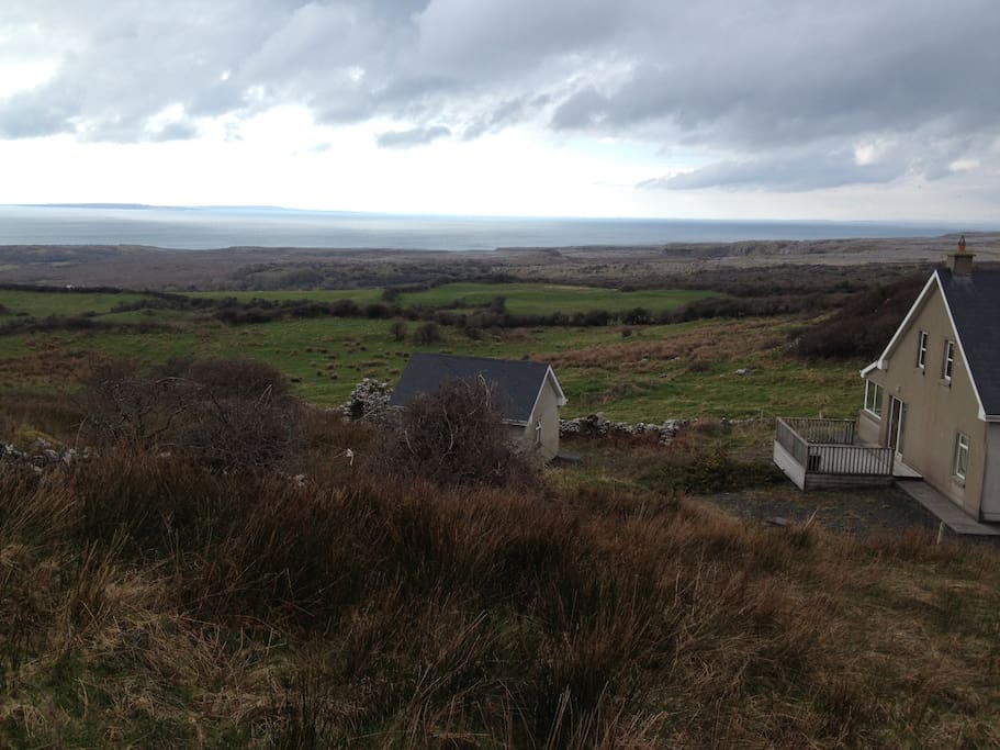 Studio cottage is nestled into the side of the hill, looking out at the Atlantic, the Aran Islands and the Burren.